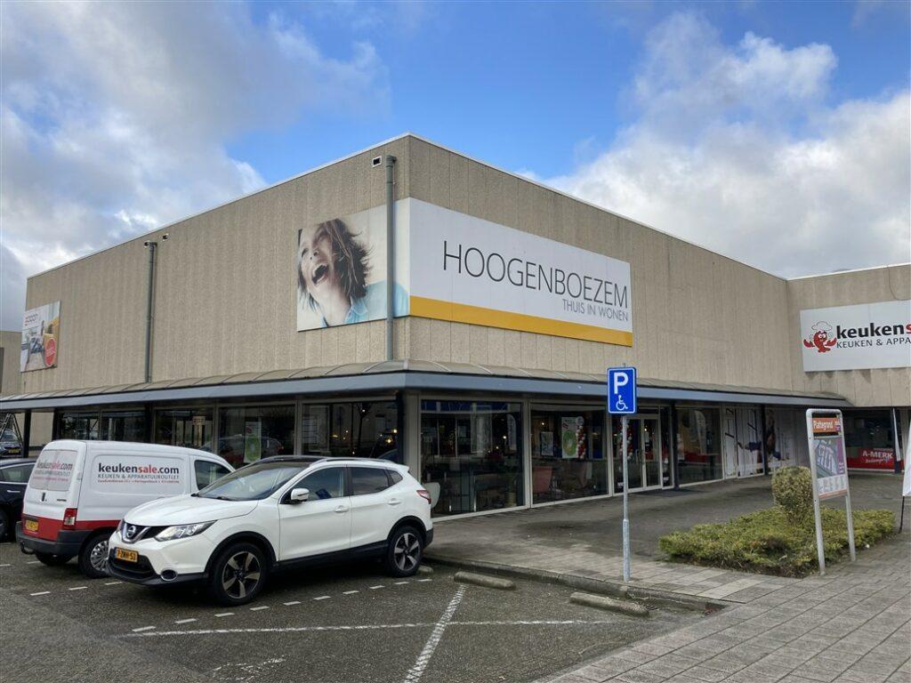 Verouderde gevelreclame Hoogenboezem Breda inclusief afbeelding